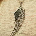 large angel wing necklace on silver chain