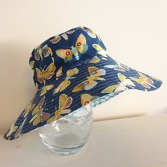 Girls wide brim summer hat in blue butterfly fabric