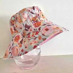 Girls wide brim summer hat in light floral fabric