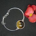 Sterling Silver Bracelet with Tiger Eye natural stone pendant with free postage