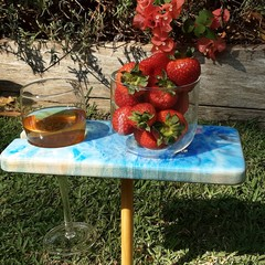 Personal outdoor mini picnic table. Resin and wood.