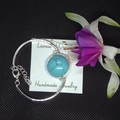 Sterling Silver Bracelet with Blue Turquoise Pendant with free postage