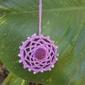 Crocheted car air freshener embellished with glass beads and felt