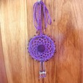 Hand crocheted car air freshener embellished with glass beads and felt.