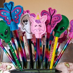"""Pencil Toppers"" with pencil."
