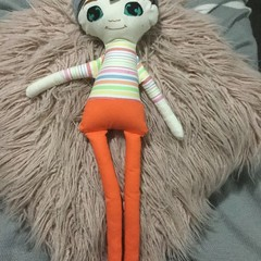 Ray of hope doll - boy with orange pants, strip shirt and brown hair