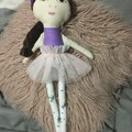 Ray of hope doll - purple with purple floral, pink skirt and brown hair