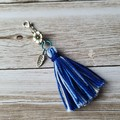 Blue and white tassel zipper pull, bag bling, flower and feather charm