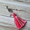 Pink and white tassel zipper pull, bag bling, tree of life and feather charm
