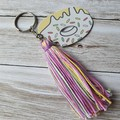 Pastel coloured tassel zipper pull/keyring with wooden donut charm