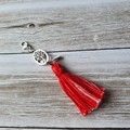 Red and white tassel zipper pull, bag bling, with tree of life and feather charm