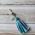 Teal and white tassel zipper pull, bag bling, flower and feather charm