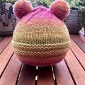Cute Pink and yellow knit hat with pom poms for a 12 month old