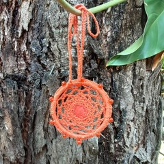 Orange Hand crocheted car air freshener embellished with glass beads and felt.