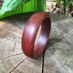 Handmade Merbau wood bangle with a natural waxed finish ideal gift