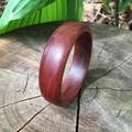 Handmade Merbau wood bangle with a natural waxed finish ideal gift