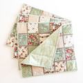 Reversible table mats. Set of 4.  Pink roses and soft greens