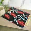 Callistemon print padded book sleeve. Booksleeve with Closure