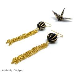 Drop earrings with gold chain tassels