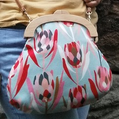 Pale blue protea bag with crossbody strap