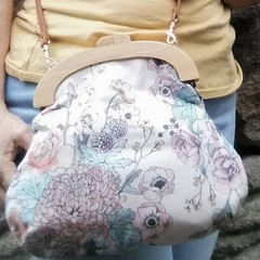 Soft pink floral bag with crossbody strap