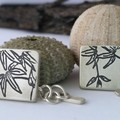 Mismatched handmade sterling silver cufflinks with maple leaf design