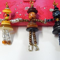 Button people, ready to wear button pendants, yellow, brown or black figures