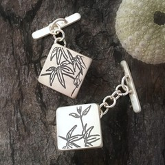 Mismatched handmade sterling silver cufflinks with maple leaf design
