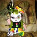 Sad clown art doll