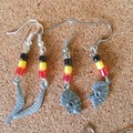 Australian Boomerang Aborigine, indigenous colours, red, black yellow pewter ear