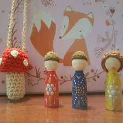 Red crochet toadstool with removable wooden gnome