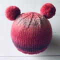 Shades of Pink Knit hat with two pom poms for a 12 month old approximately.