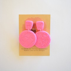 Embossed pink floral polymer clay earrings