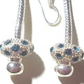 Light blue Pandora style dangle earrings . Stand out in these glitzy earrings