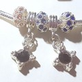 Pandora .925  bracelet blue/pink stand out in this very glitzy Silver and Pave
