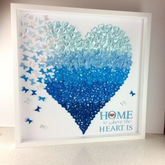 Heart from paper butterflies in ombre blue