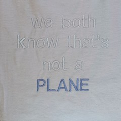 We both know that's not a plane embroidered baby bib