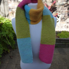 Ladies Hand Knitted Multi Coloured Scarf in Pink, Blue, Yellow and Green.