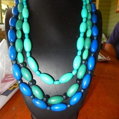 Blue, shades of blue, aqua, green wooden lightweight triple strand beaded neckla