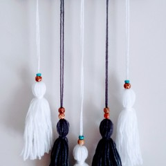 Grey and White tassel wall hanging.