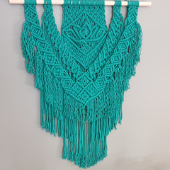 Teal green lotus flower macrame wall hanging.