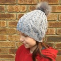 Grey cable beanie with faux fur pom