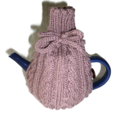 Hand knitted 4 cup tea cosy in muted neutral tones.