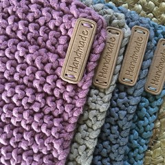 Set of 4 cotton knitted hot pads.