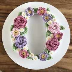 Wooden initial for door or wall on round plaque with crochet flowers - 17cm