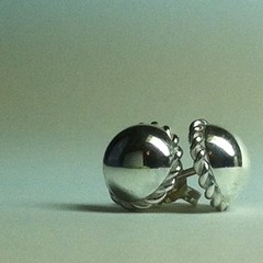 Domed stud earrings with twisted wire border handcrafted in sterling silver 925