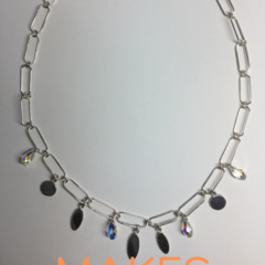 Charm necklace handcrafted with sterling silver 925 oval and disk shapes and Swa