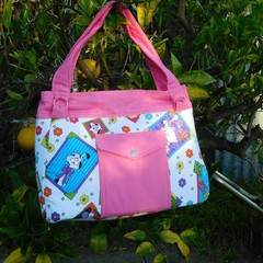 Handmade bag in bright kitty fabric with pink trim