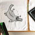 Hand printed platypus tea towel