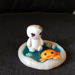 Polymer clay baby marshmallow at the beach ornament